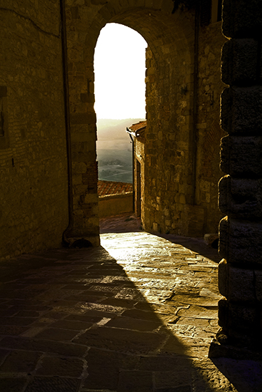 Photo of sunlit archway, Montepulciano, Tuscany, by John Hulsey
