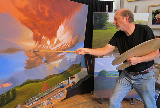 Photo of John Husey with Long Oil Painting Brush