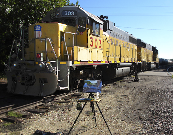 Photo of Freight Train and Artist Easel